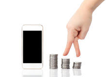 Isolated female hand up the steps of the coins to the white phon Stock Photography