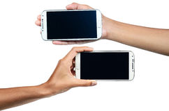 Isolated female hands holding phone. Isolated female hands holding a phone Royalty Free Stock Photos