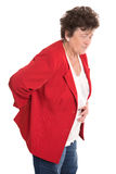 Isolated female senior in red has backache or rheumatism. Stock Photos