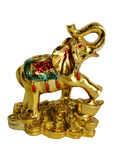 The isolated figurine of an elephant standing on golden coins on. A white background Royalty Free Stock Photo