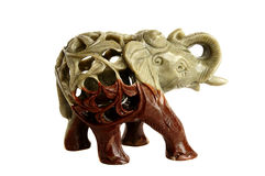 The isolated figurine of an elephant on a white bac Royalty Free Stock Photography
