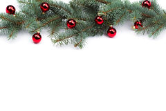 Isolated Fir branches with Christmas tree balls.  Royalty Free Stock Photo