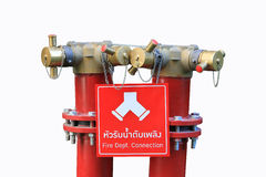 Isolated Fire department Connection. Fire water connections and pipes in red signal color on the floor isolated stock photo