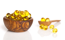 Isolated fish oil capsules Stock Images