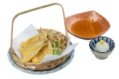 Isolated Fish and vegetable tempura in basket served with ponzu with mince radish.  Royalty Free Stock Photography