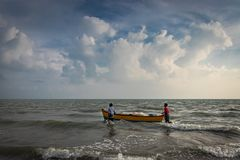 Fishermen boat in sea royalty free stock photography