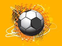 Isolated football with orange background Stock Images