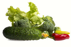 Isolated fresh broccoli and tomatos, pepper and salad Stock Photos