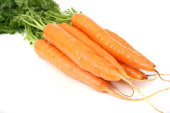 Isolated Fresh Bunch Of Carrots Zoomed In. Fresh bunch of carrots photographed on white background Stock Photography