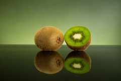 Isolated fresh and juicy green kiwi fruit on green light backgro Stock Photography