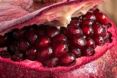 Isolated  fresh  ripe  pomegranate on white background Stock Photos