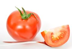 Isolated fresh tomatoes and spoon Royalty Free Stock Images