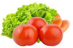 Isolated fresh vegetables. Tomatoes, carrots and salad isolated. Vegetables isolated on white background as package design element. Healthy eating. Food stock images