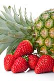 Isolated fruits - Pineapple and Strawberries Stock Photos