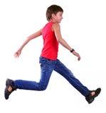 Isolated full length portrait of running jumping boy. Isolated over white full length portrait of running jumping boy. Hurry up, don't be late, kid Stock Photo