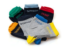 Isolated funny wool socks with days inscriptions Royalty Free Stock Photography