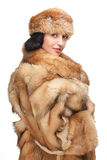 Isolated fur. Portrait of mature woman in fur isolated on white. attractive and seductive look Stock Image