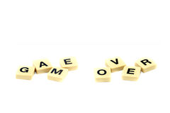 Game over bankruptcy scrabble text Isolated on whi Royalty Free Stock Photos