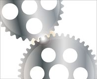 Isolated Gearing With Glare. Two interlocking gears with a bright light between the teeth Stock Photo
