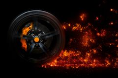 Isolated generic sport car wheel with yellow breaks drifting blazing flames of fire in motion stock images