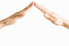Isolated gesture hands of home above white background Royalty Free Stock Images