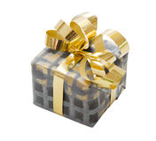 Isolated gift box for christmas in grey with a golden ribbon Stock Photography