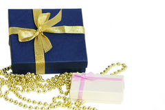 Isolated gift boxes and decoration beads Stock Photos
