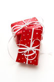 Isolated giftbox wrapped in dotted red paper Royalty Free Stock Photography