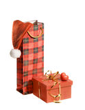 Isolated gifts with santa hat and heart Stock Image