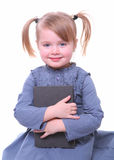 Isolated girl with a book. Isolated beautiful young girl sitting with a book Royalty Free Stock Photo