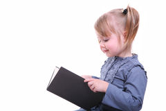 Isolated girl with a book reading. Isolated beautiful young girl sitting with a book and reading Stock Image