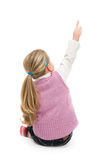 Isolated girl pointing on something Stock Photography