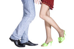 Isolated girl's and man's legs. Isolated girl's and man legs in nice shoes Royalty Free Stock Photo