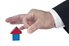 Isolated giving a flick to block house Stock Image