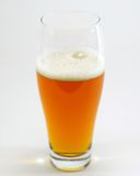 Isolated glass of beer. A glass of beer isolated on a white background Royalty Free Stock Photos