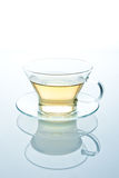 Isolated glass cup of tea or another liquid Stock Image