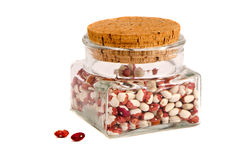 Isolated glass jar with colorful beans Royalty Free Stock Photo
