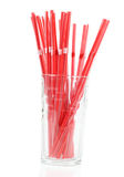 Glass with red straws Royalty Free Stock Images