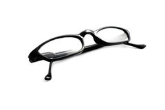 Isolated Glasses. An isolated pair of black plastic glasses Royalty Free Stock Photography