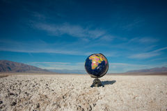 Isolated Globe in Desert. Royalty Free Stock Image