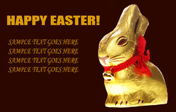 Isolated golden chocolate Easter bunny Royalty Free Stock Photos