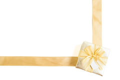 Isolated golden gift box with gold ribbon Royalty Free Stock Photo