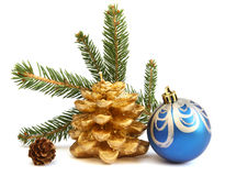 Isolated golden pine cone and blue Christmas ball Royalty Free Stock Images