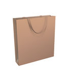 Isolated golden shopping bag with brown handle Royalty Free Stock Photography