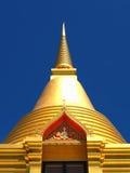 Isolated golden stupa soars into blue sky. At Thai temple Wat Rat Niyom, Nonthaburi province Royalty Free Stock Photo