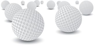Isolated golf balls. Isolated and scattered golf balls Royalty Free Stock Photos