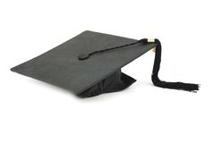Isolated graduation hat. A black graduation hat in successful Royalty Free Stock Images