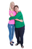 Isolated granddaughter embracing grandmother in full body length Royalty Free Stock Photo
