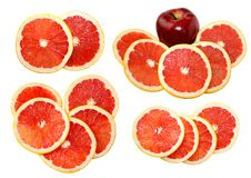 Isolated grapefruit slices with apple Royalty Free Stock Photos