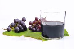 Isolated  grapes. Grapes with a glass of wine alone Royalty Free Stock Images